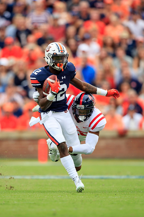 Auburn Tigers wide receiver Eli Stove (12) carries the ball past Mississippi Rebels linebacker Jarrion Street (20) during an NCAA football game, Saturday, October 7, 2017, in Auburn, AL. Auburn won 44-23. (Paul Abell via Abell Images for Chick-fil-A Peach Bowl)
