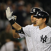 Derek Jeter and Jacoby Ellsbury, (right), New York Yankees, congratulated by team mates after Jacoby Ellsbury hit a two run homer scoring them both during the New York Yankees Vs Cincinnati Reds baseball game at Yankee Stadium, The Bronx, New York. 18th July 2014. Photo Tim Clayton