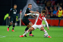 Lisandro Martinez #21 of Ajax and Jordy Clasie #20 of AZ Alkmaar in action during the Dutch Eredivisie match round 25 between Ajax Amsterdam and AZ Alkmaar at the Johan Cruijff Arena on March 01, 2020 in Amsterdam, Netherlands