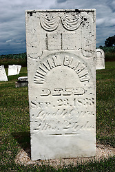 17 July 2009:  Hittle Grove cemetery, historical burial site of the Orndorff - Albright massacre of 1860, is located in Tazwell County Illinois. Grave and of William Clarno..  ..About the massacre:..On the morning of the 12th of Oct. A.D. 1860, the husband and father in whose memory this monument is erected, was called away on business, from his residence three miles southeast of Delavan, Illinois. He left his family, consisting of his wife and two small daughters.  When he returned, no little ones ran to greet him, as was their custom. This caused alarm for the welfare of his dear ones.  Entering the house, he found his wife and daughters, whom he had left in perfect health and joyful spirits a few hours earlier.  They had been  murdered while he was absent. They were now lying prostrate and weltering in their blood.  The mother and younger daughter were already dead.  The older daughter was still living and moaning piteously but unable to whisper one word to her father.  At four o'clock the next morning, death ended her suffering.  Kind friends carried them in one coffin, to their last resting place...The murderer was a former hired hand. As he was robbing the family. He killed them in order to cover up the crime.  He was later found hiding in a corn crib in Logan County and was returned to Pekin where he became the first man to be hung in Tazewell County.  .