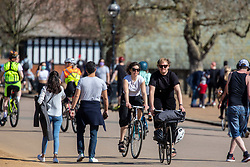 © Licensed to London News Pictures. 05/04/2020. London, UK. Londoners exercise in the warm weather. Members of the public come out to exercise In Hyde Park as temperatures reach over 21c this weekend. Hyde Park was busy with walkers, runners and cyclists as the Government urged the public not to leave home during the fine weather as the Coronavirus crisis continues. Photo credit: Alex Lentati/LNP