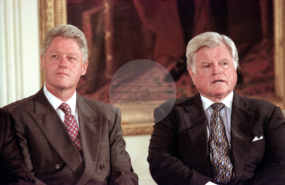 US President Bill Clinton with Senator Ted Kennedy during the signing ceremony for the Higher Education Act in the East Room of the White House October 7, 1998 in Washington, DC.
