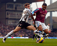 Photo: Alan Crowhurst.<br />Fulham v West Ham United. The Barclays Premiership. 23/12/2006. Fulham's Moritz Volz (L) with Hayden Mullins
