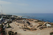 Aerial view of the amphitheater at Caesarea, Israel. The Mediterranean sea in the background. The flues of Orot Rabin power station can be seen on the far left