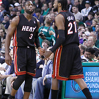 01 April 2012: Miami Heat center Ronny Turiaf (21) enters the game for Miami Heat shooting guard Dwyane Wade (3) during the Boston Celtics 91-72 victory over the Miami Heat at the TD Banknorth Garden, Boston, Massachusetts, USA. NOTE TO USER: User expressly acknowledges and agrees that, by downloading and or using this photograph, User is consenting to the terms and conditions of the Getty Images License Agreement. Mandatory Credit: 2012 NBAE (Photo by Chris Elise/NBAE via Getty Images)