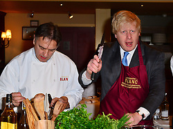 The Mayor of London, Boris Johnson, meets celebrity chef Raymond Blanc and a few of his new apprentices, as the pair encourage more businesses to establish young apprenticeships and help the Mayor to reach his target of 100,000 in the capital. Brasserie Blanc, London, United Kingdom,  6 March 2013. Photo by Nils Jorgensen / i-Images...Contact..Andrew Parsons: 00447545 311662.Stephen Lock: 00447860204379