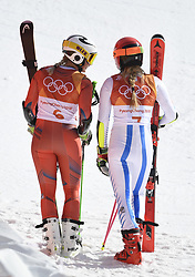 February 15, 2018 - Pyeongchang, South Korea - RAGNHILD MOWINCKEL of Norway, left, and MIKAELA SHIFFRIN of the United States watch the final competitor in the Womens Giant Slalom event Thursday, February 15, 2018 at the Yongpyang Alpine Center at the Pyeongchang Winter Olympic Games.  Photo by Mark Reis, ZUMA Press/The Gazette (Credit Image: © Mark Reis via ZUMA Wire)