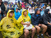 11 AUGUST 2019 - DES MOINES, IOWA: People sit in the rain and listen to Bill Weld speak at the Des Moines Register Political Soap Box at the Iowa State Fair. Weld, a two term former governor of Massachusetts, is running to be the Republican nominee for President in 2020. He campaigned at the Iowa State Fair Sunday. He is launching a primary bid against incumbent Donald Trump in New England states and some western states where Trump is not popular.         PHOTO BY JACK KURTZ