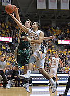 WICHITA, KS - NOVEMBER 14:  Guard Fred VanVleet of the Wichita State Shockers drives to the basket against guard Omar Prewitt #4 of the William & Mary Tribe during the first half on November 14, 2013 at Charles Koch Arena in Wichita, Kansas.  (Photo by Peter Aiken/Getty Images) *** Local Caption *** Fred VanVleet;Omar Prewitt