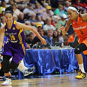 UNCASVILLE, CONNECTICUT- MAY 26:  Kristi Toliver #20 of the Los Angeles Sparks drives to the basket past Jasmine Thomas #5 of the Connecticut Sun during the Los Angeles Sparks Vs Connecticut Sun, WNBA regular season game at Mohegan Sun Arena on May 26, 2016 in Uncasville, Connecticut. (Photo by Tim Clayton/Corbis via Getty Images)