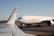 Emirates Airlines, Boeing 777-300 as seen from an Israeli El Al plane. at Linate airport, Milan, Italy
