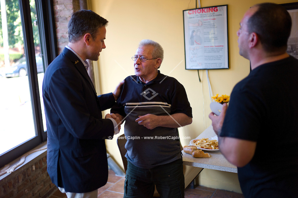 Mark Murphy (D), congressional candidate in Staten Island chats with Gregory Tartamella at a Vincent's pizza shop in Staten Island. ..Photo © Robert Caplin..