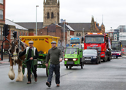 "© under license to London News Pictures. 1/4/2010: Fuel protest organiser Tony Cauchi (R), who runs local business Salford Skip Hire. A skip company owner caused tailbacks in Manchester this morning (Fri) by deciding to move one of his skip's by horse and cart. Mr Cauchi organised this morning's fuel protest, along with several other local business, over the last four months. He says the 1p reduction in fuel tax is ""no help"" and calls for a 10 pence reduction on the price of fuel. Credit should read ""Joel Goodman/LNP""."