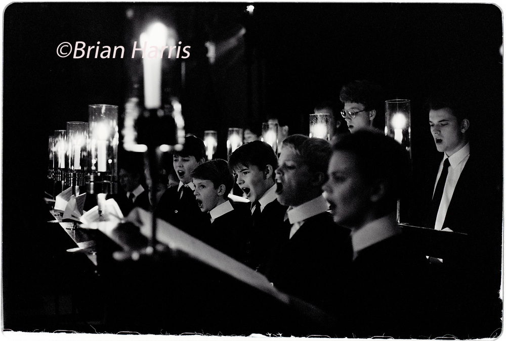Kings College Chapel Choir December 1992 scanned 2021<br />Photographed in the lead up to the traditional Festival of Nine Carols in King's College under the musical directorship of Stephen Cleobury, later Sir Stephen. Sire Stephen died in 2019.<br />Sir Stephen John Cleobury CBE  was an English organist and music director. He worked with the Choir of King's College, Cambridge, where he served as music director from 1982 to 2019<br />The Choir of King's College, Cambridge is an English choir. It is considered one of today's most accomplished and renowned representatives of the great English choral tradition. It was created by King Henry VI, who founded King's College, Cambridge, in 1441, to provide daily singing in his Chapel, which remains the main task of the choir to this day.<br />The statutes of the College provide for sixteen choristers. These are boys who are educated at King's College School. They come from a variety of backgrounds with bursaries being available to families unable to afford the subsidised school fees. Boys usually join the choir as probationers aged eight following a successful audition at age six or seven. After two years as probationers, they enter the choir as full choristers, departing three years later or earlier if their voice changes