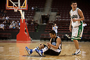 .Navajo Pine Warrior Joshua Poyer (4) sits momentarily on floor after missing a last second shot at halftime as Hagerman Bobcat Ryan Gomez (11) Wednesday nights game at the Santa Anna Star Center in Rio Rancho NM. Hagerman defeated Navajo Pine 76-61.
