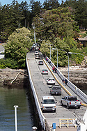 Vehicles leaving the BC Ferries vessel Salish Eagle at the Sturdies Bay Ferry Terminal on Galiano Island.  Photographed from the Salish Eagle in Sturdies Bay at Galiano Island, British Columbia, Canada.