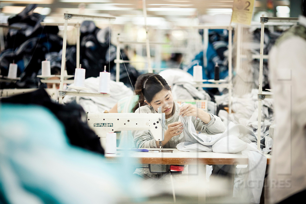 Female worker in a clothes factory of Cam Ranh, Vietnam, Southeast Asia