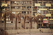 Downtown Kuwait city with dead palm trees after the end of the Gulf War in 1991. More than 700 wells were set ablaze by retreating Iraqi troops creating the largest man-made environmental disaster in history.