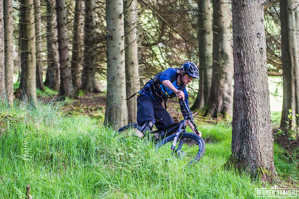 Ed Thomsett nips through the trees at Kielder Forest on his Vitus Sommet CR.
