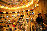Visitors walk the main hall at the Venetian casino in Macau, China, on February 24, 2008. The Venetian Macao-Resort-Hotel is a 163,000 square foot casino featuring 405 slots and 277 table games. Macao has overtaken Las Vegas with a gambling revenue of 7 billion U.S. dollars in 2006 (Las Vegas' was 6.6 billion U.S. dollars), and is now the world's top casino hut. Photo by Lucas Schifres/Pictobank