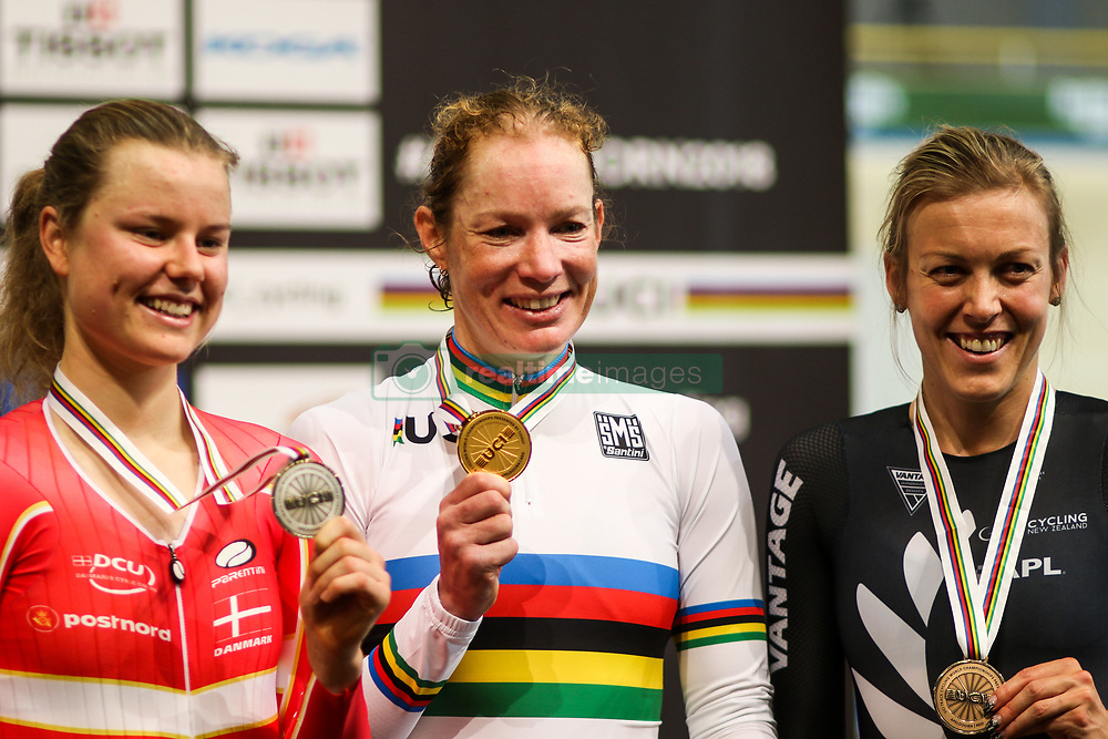 March 2, 2018 - Apeldoorn, Netherlands - (L/R) Silver medallist Demark's Amalie Dideriksen, Gold medal winner Netherland's Kirsten Wild and Bronze medallist New Zealand's Rushlee Buchanan pose on the podium after taking part in the women's omnium during the UCI Track Cycling World Championships in Apeldoorn on March 2, 2018. (Credit Image: © Foto Olimpik/NurPhoto via ZUMA Press)