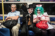 UNITED KINGDOM, London: 27-28 May 2017 Cosplay fans dressed as Batman super villains Penguin (centre) and The Joker (right) make their way to the MCM London Comic Con on the Jubilee Line of the London Underground. <br /> The comic convention, which will be visited by tens of thousands of comic book and cosplay fans, is being held at London's ExCel this weekend. Rick Findler / Story Picture Agency