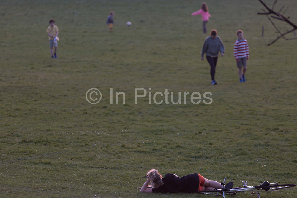 As the UK Prime Minister Boris Johnson suffers from Coronavirus and remains in intensive care in hospital - with a record 938 UK daily deaths recorded, a total of 7,097, Londoners keep to government guidelines for daily exercise and practicing social distancing in Ruskin Park, a green space in Herne Hill, Lambeth, on 8th April 2020, in south London, England.