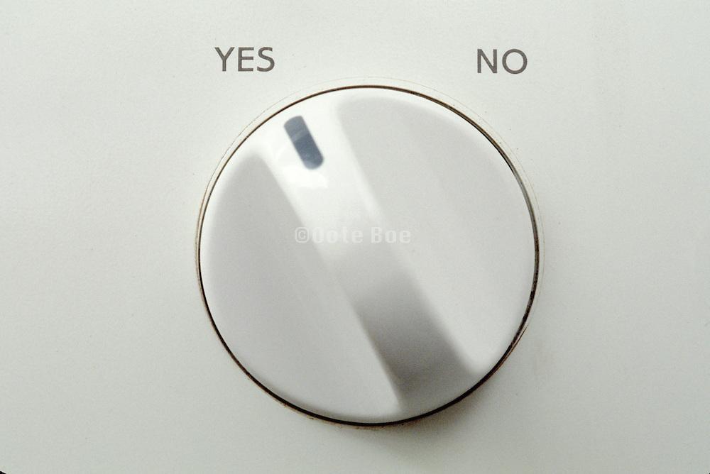 detail of washing machine knob set to yes