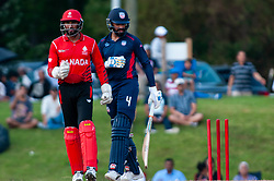 September 22, 2018 - Morrisville, North Carolina, US - Sept. 22, 2018 - Morrisville N.C., USA - Team USA JASKARAN MALHA (4) looks at the stumps after the bails were knocked off by Team Canada HAMZA TARIQ (61) during the ICC World T20 America's ''A'' Qualifier cricket match between USA and Canada. Both teams played to a 140/8 tie with Canada winning the Super Over for the overall win. In addition to USA and Canada, the ICC World T20 America's ''A'' Qualifier also features Belize and Panama in the six-day tournament that ends Sept. 26. (Credit Image: © Timothy L. Hale/ZUMA Wire)