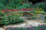 63821-09411 Wheelbarrow with mulch in flower garden -  Marion Co.  IL