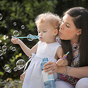 A mother and daughter blow bubbles in their yard in Columbia, S.C. ©Travis Bell Photography