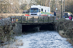 © Licensed to London News Pictures. 07/12/2015. Staveley UK. Picture shows a Police underwater search vehicle next to the River Gowan (a tributary to the river Kent ) in Staveley near Kendal. Police were called at 10 am on Sunday to reports that a man had fallen into the river at Staveley & officers along with the underwater search team located the body in the Kendal Area. Photo credit: Andrew McCaren/LNP