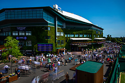 Spectators are led into the grounds at the start of day two of the Wimbledon Championships at the All England Lawn Tennis and Croquet Club, Wimbledon.