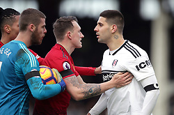 Fulham's Aleksandar Mitrovic (right) exchanges words with Manchester United's Chris Smalling, David de Gea and Phil Jones during the Premier League match at Craven Cottage, London.