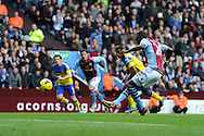 Aston Villa's Christian Benteke takes but misses an early penalty. . Barclays Premier League, Aston Villa v Everton at Villa Park in Aston, Birmingham on Saturday 26th Oct 2013. pic by Andrew Orchard, Andrew Orchard sports photography,