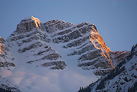 Rugged peaks of the Canadian Rockies glowing in a winter sunset, Mount Robson Provincial Park British Columbia Canada