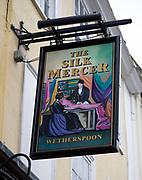 Sign outside The Silk Mercer, Wetherspoons pub, Devizes, Wiltshire, England, UK