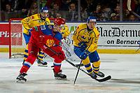 KELOWNA, BC - DECEMBER 18:  Erik Brännström #12 of Team Sweden stick checks Ivan Muranov #23 of Team Russia at Prospera Place on December 18, 2018 in Kelowna, Canada. (Photo by Marissa Baecker/Getty Images)***Local Caption***