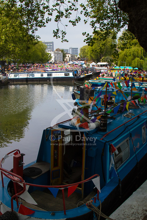 Little Venice, London, April 30th 2017. Narrowboaters from all over the uK gather for the annual Canalway Cavalcade, held on the May Day Bank holiday weekend, organised by the Inland Waterways Association, where boaters get the chance to display their immaculately prepared and brightly painted craft as well as compete in various manoeuvring tests. PICTURED: Narrowboats are moored in Paddington Basin where the Regents and Grand Union canals meet.<br /> Credit: ©Paul Davey<br /> To licence contact: <br /> Mobile: +44 (0) 7966 016 296<br /> Email: paul@pauldaveycreative.co.uk<br /> Twitter: @pauldaveycreate