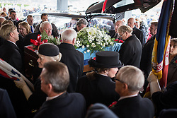 © Licensed to London News Pictures . 11/11/2012 . Lytham Park Crematorium , UK . The coffin is carried from the hearse . Hundreds of strangers at the funeral of World War Two veteran Harold Jellicoe Percival today (Monday 11th November 2013) . The funeral is timed to coincide with the First World War armistice , the 95th anniversary of which is at 11am today (Monday 11th November 2013) . The RAF Bomber Command veteran died in his sleep on 25th October 2013 , aged 99 , at Alistre Lodge Nursing Home in St Annes , Lancashire , with no immediate family . Photo credit : Joel Goodman/LNP