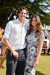 MR RUPERT FINCH and his wife LADY NATASHA RUFUS-ISAACS at the Summer Solstice Party during the Boodles Tennis event hosted by Beulah London and Taylor Morris at Stoke Park, Park Road, Stoke Poges, Buckinghamshire on 21st June 2014.