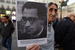 March 28, 2019 - Madrid, Madrid, Spain - A protester is seen holding a picture of Spanish musician Antonio Martinez Palacios, missing father during the Spanish dictatorship of Francisco Franco (1936-1975), as he takes part during the demonstration..Around hundred people gathered in Madrid to protest against immunity for the crimes committed during the Spanish Civil War by Francisco Franco's dictatorship, and to demand justice for victims and relatives. (Credit Image: © John Milner/SOPA Images via ZUMA Wire)