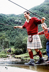 File photo dated 18/08/87 of the Prince of Wales negotiating a 2 inch wide wire bridge during a trek in the foothills of Ben Nevis with the Lochaber Mountain Rescue Team.