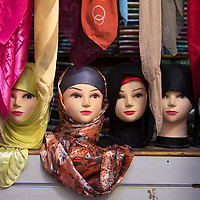 Africa, Morocco, Fes. Moroccan Head scarves on mannequin heads in market.