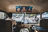 Yangon, Myanmar - November 16, 2011: View from inside a bus driving through Yangon en route to the international airport to drop off departing passengers.