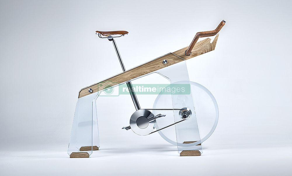"""April 3, 2017 - inconnu - An exercise bike which doubles as a classy piece of furniture could be a hit with exercise fans who don't have room for a home gym.Italian company Adriano Design said the glass and wood Fuoripista represents a new way of interpreting a fitness accessory.The company says it lets users enjoy a spin without compromise, on a machine you won't have to hide under the bed, in the closet or the basement.Bracket on the front for a tablet uses an app to display different terrains and data such as distance travelled and calories burned.A spokesman for the company, based in Turin, said:"""" No longer gym exclusive but so beautiful that becomes an object of desire, to show off, to praise, one you would ride with pride and joy. """"A dream machine along with you would ride away some of the most spectacular cycling routes in the world, virtualised on a tablet mounted on its front. """"It was created by Adriano Design to mark 20 years of the SaloneSatellite design show in Milan this year.It is part of a collection nominated SaloneSatellite 20 anni of pieces designed specifically for the occasion by international designers.Adriano has previously reinvented the foosball table with Teckell, the pool table with Filotto and ping pong table with Lungolinea of Impatia.# VELO D'APPARTEMENT DESIGN (Credit Image: © Visual via ZUMA Press)"""