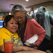 Kara is hugged by her auntie, Tresa Sufkie. Kara and Lester and their family had dinner at Denny's in Tuba City after the 10-day Hopi Wedding ended,  March 28, 2019.