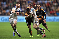 Wasps' Lima Sopoaga is tackled by Bath's Max Wright (left) and Will Chudley during the Gallagher Premiership match at the Ricoh Arena, Coventry.
