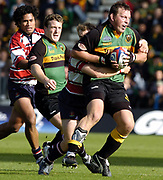 Northampton, Northamptonshire,  18th September 2004, Franklyn Gardens, [Mandatory Credit Pete Spurrier/Intersport Images]Zurich Premiership - Northampton - Saints vs Gloucester. <br /> <br /> Steve Thompson is caught in James Simpson-Daniel's tackle from behind. John Rudd and Terry Fanolua [left] supporting the play.