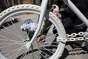 Families and friends of New Yorkers killed while bicycling on New York City streets gather at an Unnamed Ghost Bike memorial at Franklin Ave. and Flushing Ave. in Brooklyn, NY, on Sunday, April 21, 2013 as they participate in the 8th Annual Ghost Bike Memorial Ride. The ride visited the 20 white-painted Ghost Bikes installed at the scene of bicyclist fatalities in five boroughs before converging at the intersection of Queens Boulevard and Jackson Avenue to dedicate a memorial to all of the cyclists who were killed in traffic crashes in 2012 whose deaths did not make the news...According to the New York City Department of Transportation, 136 pedestrians and 18 bicyclists were killed in 2012. In 2011, 134 pedestrians and 22 bicyclists were killed on New York City streets. To date, at least two bicyclists have been killed in 2013...Photograph by Andrew Hinderaker for the Ghost Bike Project.
